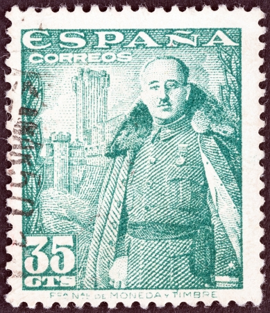 SPAIN - CIRCA 1948: A stamp printed in Spain shows General Franco and Castillo de la Mota, circa 1948.