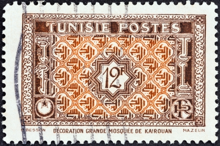 TUNISIA - CIRCA 1947: A stamp printed in Tunisia shows Arabesque Ornamentation from Great Mosque at Kairouan , circa 1947.