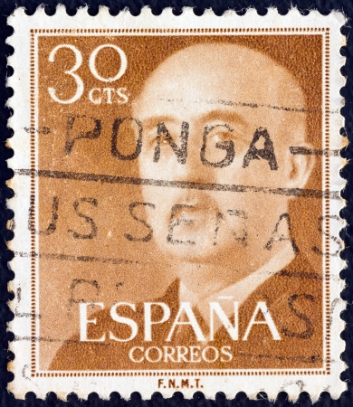 SPAIN - CIRCA 1955: A stamp printed in Spain shows a portrait of Francisco Franco, circa 1955.  Stock Photo - 20527002