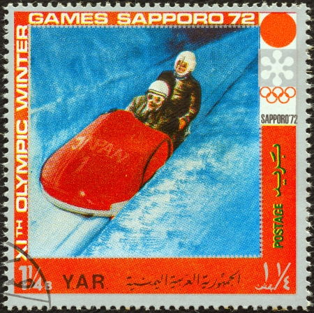 YEMEN ARAB REPUBLIC - CIRCA 1972: A stamp printed in Yemen from the  XI Olympic Winter Games, Sapporo issue shows bobsleigh, circa 1972.