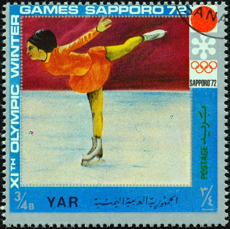 YEMEN ARAB REPUBLIC - CIRCA 1972: A stamp printed in Yemen from the  XI Olympic Winter Games, Sapporo issue shows figure skating, circa 1972.