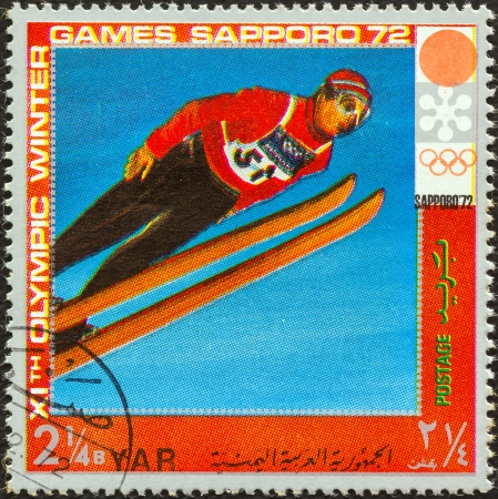 YEMEN ARAB REPUBLIC - CIRCA 1972: A stamp printed in Yemen from the  XI Olympic Winter Games, Sapporo issue shows ski jumping, circa 1972.