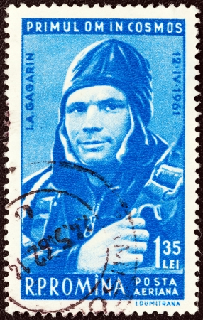 gagarin: ROMANIA - CIRCA 1961: A stamp printed in Romania from the Worlds First Manned Space Flight issue shows Yuri Gagarin in Capsule, circa 1961.