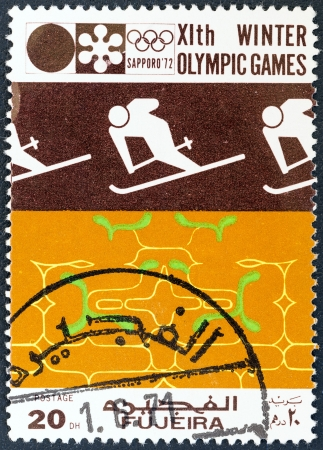 FUJAIRAH EMIRATE - CIRCA 1972: A stamp printed in United Arab Emirates from the Winter Olympic Games - Sapporo, Japan issue shows Slalom skier, circa 1972.