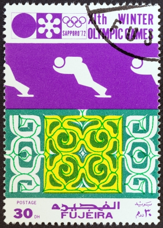 FUJAIRAH EMIRATE - CIRCA 1972: A stamp printed in United Arab Emirates from the Winter Olympic Games - Sapporo, Japan issue shows Ski jumper, circa 1972.