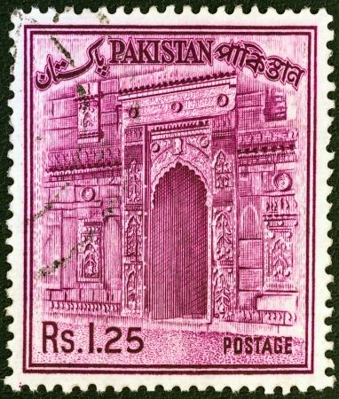 PAKISTAN - CIRCA 1961: A stamp printed in Pakistan shows the gateway of Chota Sona Masjid, Bangladesh, circa 1961.  Stock Photo - 20804711