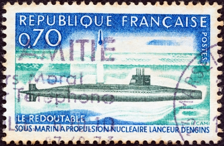 postes: FRANCE - CIRCA 1969: A stamp printed in France shows the first French Nuclear Submarine Le Redoutable, circa 1969.  Editorial