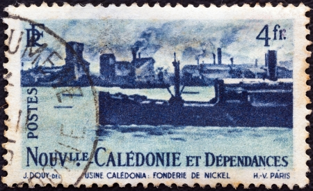NEW CALEDONIA - CIRCA 1948: A stamp printed in France shows Nickel foundry and ship, circa 1948.