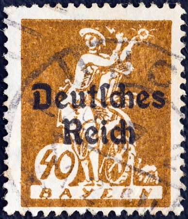 reich: BAVARIA - CIRCA 1920: A stamp printed in Bavaria with a Deutsches Reich overprint shows an allegory of electricity, harnessing light to a water wheel, circa 1920.  Editorial