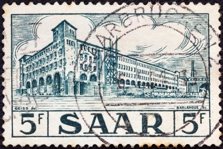 saar: SAAR - CIRCA 1952: A stamp printed in France shows General Post Office, Saarbrucken, circa 1952.  Editorial