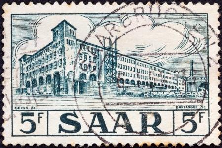 saar: SAAR - CIRCA 1952: A stamp printed in France shows General Post Office, Saarbrucken, circa 1952.  Editorial