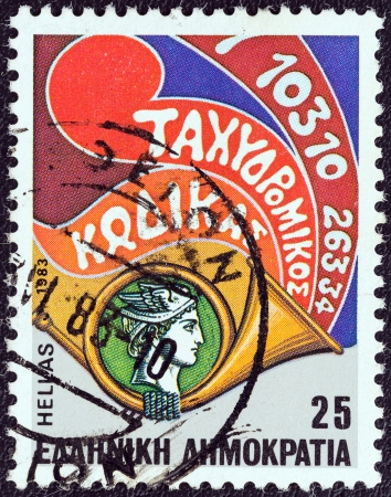 timbre: GREECE - CIRCA 1983: A stamp printed in Greece from the Inauguration of Postcode issue shows Hermes head within posthorn, circa 1983.
