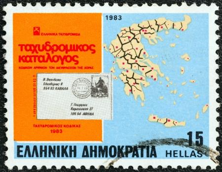 GREECE - CIRCA 1983: A stamp printed in Greece from the Inauguration of Postcode issue shows letter and map of Greece showing Postcode Districts, circa 1983.