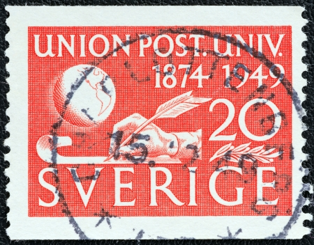 upu: SWEDEN - CIRCA 1949: A stamp printed in Sweden issued for the 75th anniversary of U.P.U. shows Globe and Hand Writing, circa 1949.  Editorial