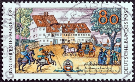 timbre: GERMANY - CIRCA 1984: A stamp printed in Germany from the Stamp Day issue shows Taxis Posthouse, Augsburg, circa 1984.