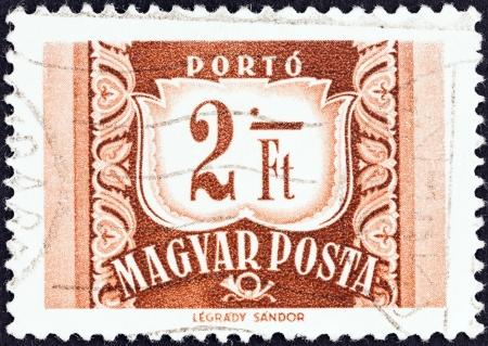 posthorn: HUNGARY - CIRCA 1958: A stamp printed in Hungary shows value and posthorn, circa 1958.  Editorial