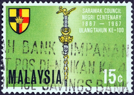 timbre: MALAYSIA - CIRCA 1967: A stamp printed in Malaysia from the Centenary of Sarawak Council issue shows Mace and Shield, circa 1967.