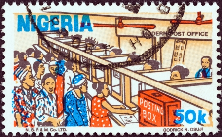 NIGERIA - CIRCA 1986: A stamp printed in Nigeria from the Nigerian life issue shows a modern post office, circa 1986.