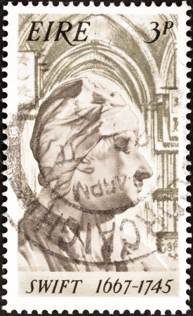 satirist: IRELAND - CIRCA 1967: A stamp printed in Ireland issued for the 300th birth anniversary of Jonathan Swift shows Jonathan Swift (1667-1745), circa 1967.