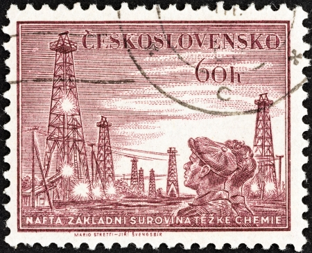 timbre: CZECHOSLOVAKIA - CIRCA 1953: A stamp printed in Czechoslovakia from the Miners Day issue shows Miners and colliery shaft head, circa 1953.