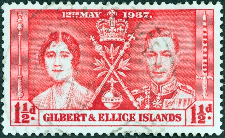 vi: GILBERT AND ELLICE ISLANDS - CIRCA 1937: A stamp printed in United Kingdom from the Coronation&qu ot; issue shows King George VI and Queen Elizabeth, circa 1937.
