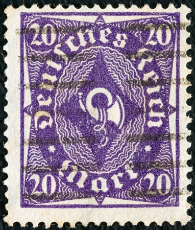 bundes: GERMANY - CIRCA 1921  A stamp printed in Germany shows a posthorn, circa 1921   Editorial