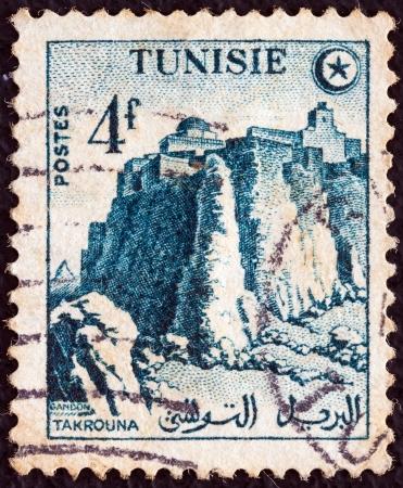 ramparts: TUNISIA - CIRCA 1954  A stamp printed in Tunisia shows Takrouna ramparts, circa 1954   Editorial