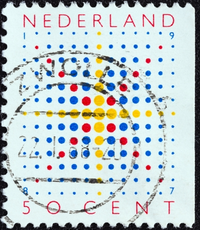 orange nassau: NETHERLANDS - CIRCA 1987  A stamp printed in the Netherlands from the  Christmas  issue shows a star, circa 1987   Editorial