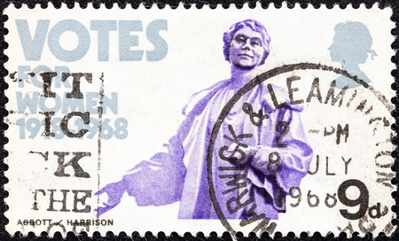 granting: UNITED KINGDOM - CIRCA 1968  A stamp printed in United Kingdom from the  British anniversaries  Granting of votes to women  issue shows Mrs  Emmeline Pankhurst  statue , circa 1968