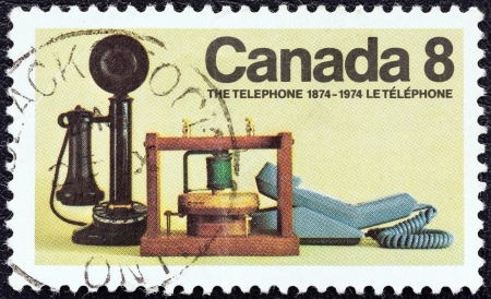 CANADA - CIRCA 1974  A stamp printed in Canada issued for the 100th anniversary of the telephone shows historical telephones, circa 1974