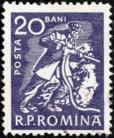 stempeln: ROMANIA - CIRCA 1960  A stamp printed in Romania shows a Miner, circa 1960