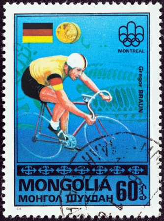 west of germany: MONGOLIA - CIRCA 1976  A stamp printed in Mongolia from the  Olympic Games, Montreal  Gold Medal Winners  issue shows Gregor Braun of West Germany  cycling , circa 1976