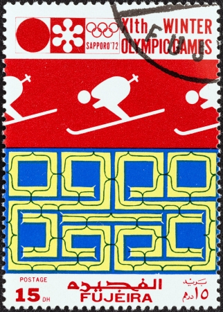 FUJAIRAH EMIRATE - CIRCA 1972  A stamp printed in United Arab Emirates from the  Winter Olympic Games - Sapporo, Japan  issue shows Downhill skier, circa 1972