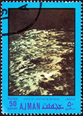 timbre: AJMAN EMIRATE - CIRCA 1970  A stamp printed in United Arab Emirates from the  Space exploration  issue shows craters on the Moon, Apollo 10, circa 1970