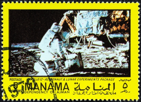 moonwalk: MANAMA DEPENDENCY - CIRCA 1970  A stamp printed in United Arab Emirates from the  Space exploration  issue shows Apollo 12, Astronaut and lunar experiments package, circa 1970   Editorial