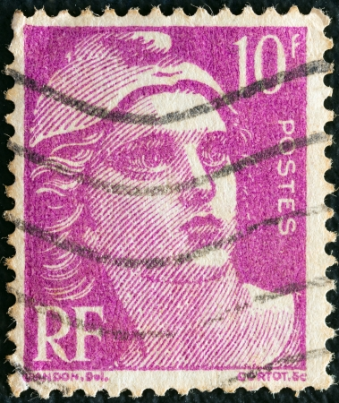 stempeln: FRANCE - CIRCA 1945  A stamp printed in France shows Marianne, circa 1945   Editorial