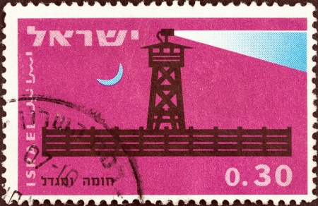 stockade: ISRAEL - CIRCA 1963  A stamp printed in Israel from the  25th anniversary of the Stockade and Tower villages  issue shows Completed stockade at night, circa 1963