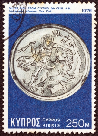 kypros: CYPRUS - CIRCA 1976  A stamp printed in Cyprus shows a silver dish from 6th century AD found in Cyprus and now exposed in Metropolitan museum New York, circa 1976