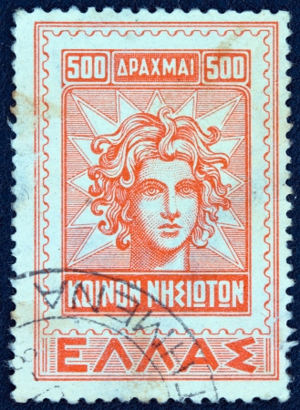 GREECE - CIRCA 1947  A stamp printed in Greece from the   Dodecanese integration  issue shows Apollo Helios god portrait from an older Rhodian stamp, circa 1947
