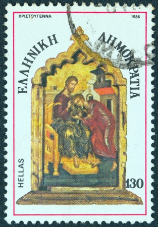enthroned: GREECE - CIRCA 1986  A stamp printed in Greece from the  Christmas  issue shows Christ Enthroned with St  John the Evangelist, triptych panel, circa 1986  Editorial