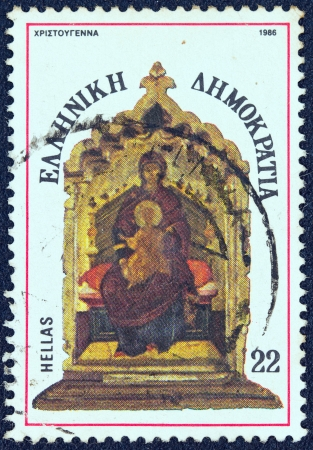 enthroned: GREECE - CIRCA 1986  A stamp printed in Greece from the  Christmas  issue shows Madonna and child enthroned, circa 1986