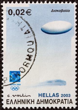 lanzamiento de disco: GRECIA - CIRCA 2003 Un sello impreso en Grecia desde el 2004 tema Material deportivo Atenas muestra un disco de lanzamiento de lanzamiento de eventos, alrededor de 2003