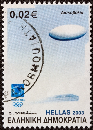 GREECE - CIRCA 2003  A stamp printed in Greece from the  Athens 2004  Sports equipment  issue shows a discus  discus throw event , circa 2003   Stock Photo - 22038165