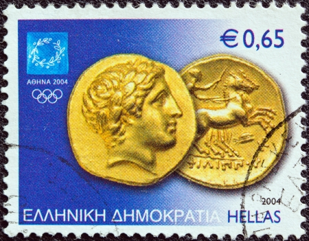 greek coins: GREECE - CIRCA 2004  A stamp printed in Greece from the  Athens Olympic games 2004  Ancient coins  issue shows a Gold Stater of Philip II of Macedonia, circa 2004