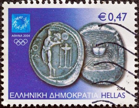 ギリシャ - 2004年スタンプ頃アテネ オリンピック 2004年の古代の問題番組の 3 ドラクマ銀貨コイン コス島、2004 年頃からギリシャで印刷 報道画像