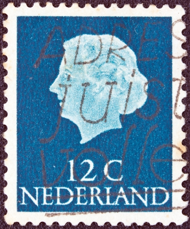 nederlan: NETHERLANDS - CIRCA 1953  A stamp printed in the Netherlands shows Queen Juliana, circa 1953   Editorial