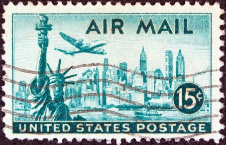 USA - CIRCA 1947  A stamp printed in USA shows statue of Liberty, New York city and a Lockheed Constellation airplane, circa 1947