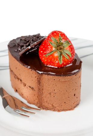 Small chocolate cake with strawberry isolated photo