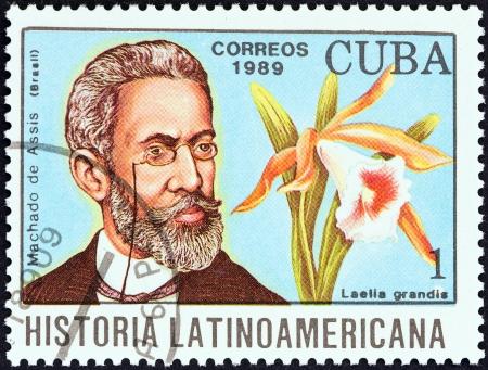 CUBA - CIRCA 1989  A stamp printed in Cuba from the  Latin American History  4th series   issue shows Machado de Assis and Laelia grandis  Brazil , circa 1989