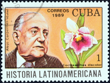 CUBA - CIRCA 1989  A stamp printed in Cuba from the  Latin American History  4th series   issue shows Alejo Carpentier and Cochleanthes discolor  Cuba , circa 1989
